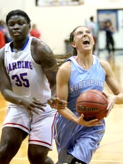 Harding Academy's Antoinette Lewis defends Northpoint's Ashtyn Baker. Both teams play in the Division 2-A West Regional basketball tournament Tuesday night.
