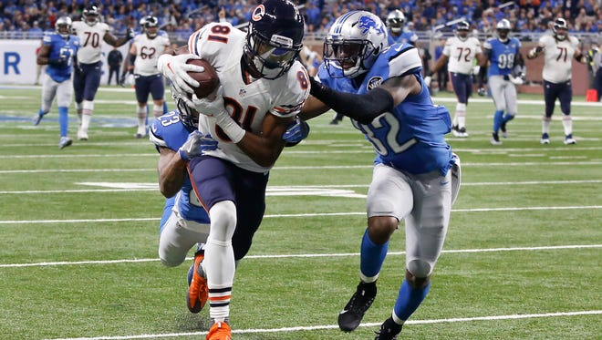 Chicago Bears wide receiver Cameron Meredith (81) runs for a 31-yard touchdown reception as Detroit Lions cornerback Darius Slay (23) and strong safety Tavon Wilson (32) defend in the second half of an NFL football game in Detroit, Sunday, Dec. 11, 2016.