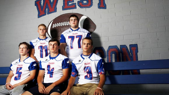 West Henderson football players, left to right, Landon Owen, Kyler Stalks, Peyton Frisbee, Sam Gentry and Brandon Whitaker are home for Thursday's live TV game against Hendersonville.