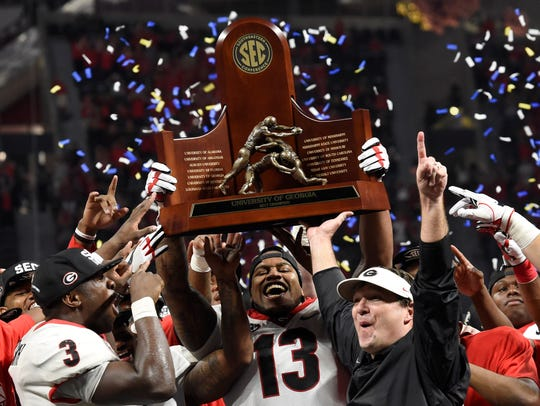 Georgia head coach Kirby Smart celebrates with his