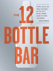 "This undated image provided by Workman Publishing shows the cover of the book ""The 12 Bottle Bar"" by Lesley Jacobs Solmonson and her husband David Solmonson. The book includes cocktail recipes focusing on only the most essential ingredients for great drinking."