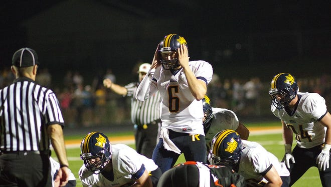 Regina QB Drew Cook communicates with his offense during a key play in game at Solon Stadium on Aug. 29, 2014. Solon snapped Regina's 56-game winning streak, winning on a two-point conversion in overtime, 29-28.