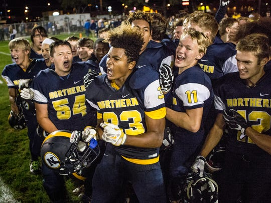 Port Huron Northern players celebrate beating Marine City in a football game Thursday, September 1, 2016 at Memorial Stadium in Port Huron.
