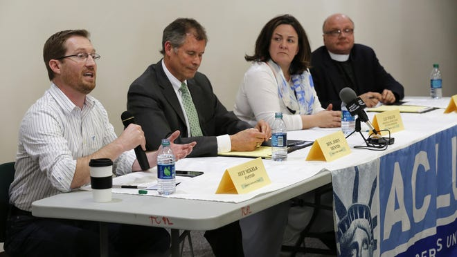 """Jeff Mikels, left, Pastor, Lafayette Community Church, speaks during """"Religious Freedom Restoration Act: What is the Impact in Indiana,"""" a panel discussion April 1 at Tippecanoe County Public Library. Mikels said the people in his congregation didn't think RFRA was a big deal."""
