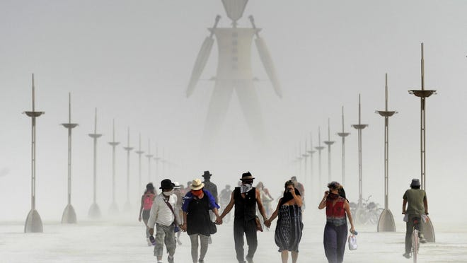Images of Burning Man participants during a dusty morning on the Black Rock Desert of Gerlach, Nevada August 29, 2014.