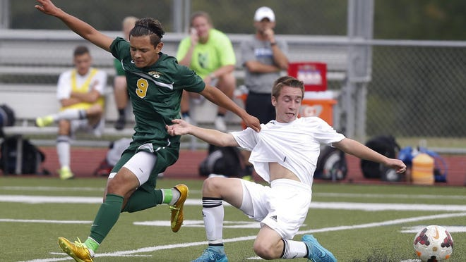 St. Mark's Santiago Sanguino (left) tangles with St. Georges' Matt Mitchell in the first half of St. Georges' 2-1 home win against St. Mark's Tuesday.