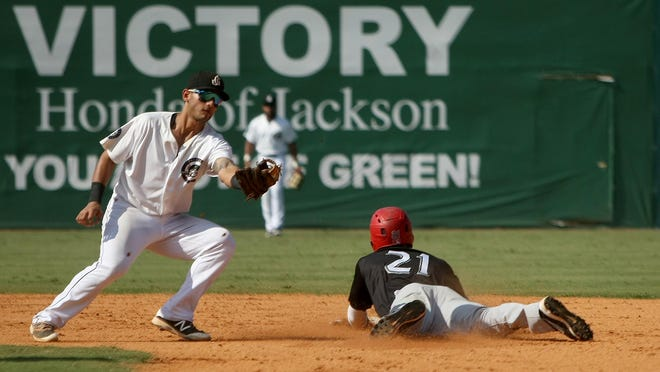 Jackson Generals second baseman Tim Lopes (7) cannot get the out as Chattanooga Lookouts shortstop Niko Goodrum (21) steals second base at The Ballpark at Jackson on Monday.
