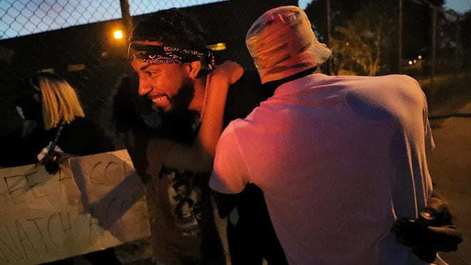 Shawn Mansfield is swarmed by a group of supporters after being released from the Summit County Jail Saturday, July 25, 2020, in Akron, Ohio.