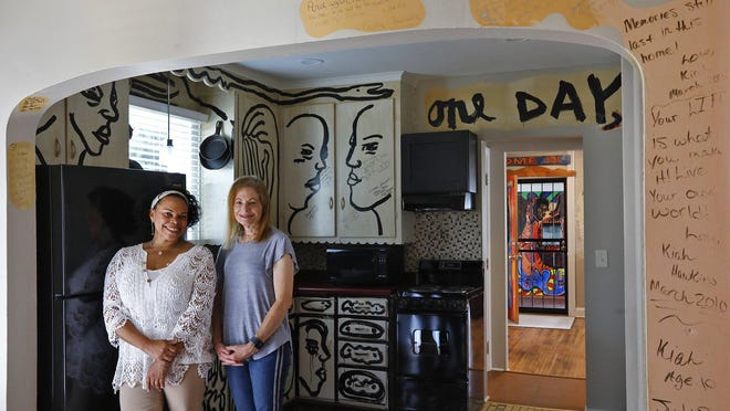Co-curators Deidre Hamlar, left, and Carole Genshaft in the kitchen of the renovated home of artist Aminah Robinson. The home will host an artist in residence in the future.