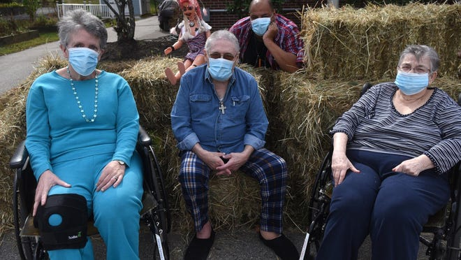 Riverside Rest Home residents star in a movie directed by activities aide Josey King for the upcoming Halloween experience. From left are Barbara Sprague, Dennis Mullen, director Josey King and Caroline Croteau.