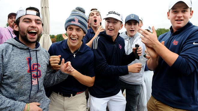 The Lincoln-Sudbury golf team celebrates after learning they won the Div. 1 state championship this fall at the Haven Country Club in Boylston. Three Warriors were named to the Daily News' All-Star team.