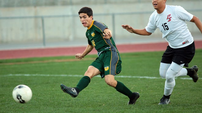 Coachella Valley's Ramon Felix (11, green) gets past Palm Springs' Octavio Ibanez (15, white) to take a shot on goal while playing the Indians on the road Wednesday in Palm Springs.