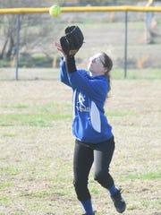 Cotter right-fielder Kristen McCollum catches a fly
