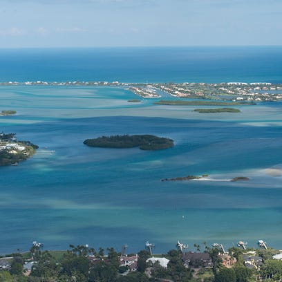 An aerial image shows the St. Lucie River, the Indian