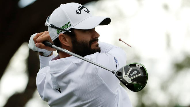 Adam Hadwin watches his tee shot on the third hole during the final round of the CareerBuilder Challenge golf tournament on the Stadium Course at PGA West, Sunday, Jan. 22, 2017, in La Quinta, Calif. (AP Photo/Chris Carlson)