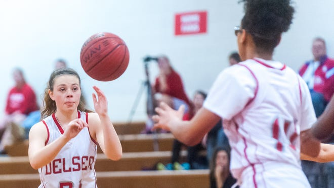 Delsea guard Cara McCoy (21) passes to forward Glory Morton (14) against Highland Regional at Delsea Regional High School in Franklin Township on Thursday, February 2.