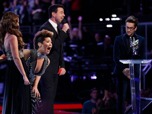 Tessanne Chin, second from left, reacts after hearing her name announced Tuesday as the winner of 'The Voice.'