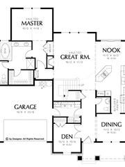 The luxurious master suite is located on the main floor for convenience.