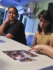 Family members recall the life of homicide victim, Nathan Joseph Villagomez Paet, as they sit in a garage in Yona on Dec 3. Photographed are his aunt Tami Paet Matanane, center, and sister-in-laws Lena Paet, left, and Arlene Paet.