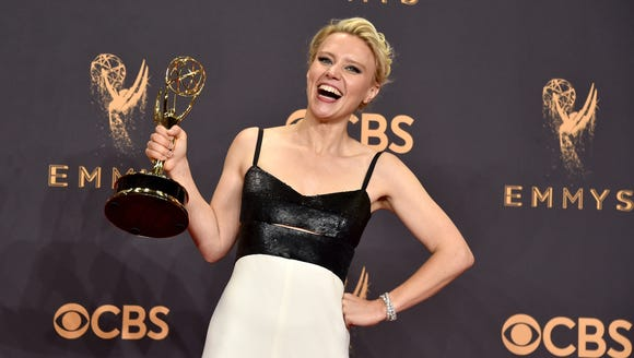 Kate McKinnon poses with her Emmy.
