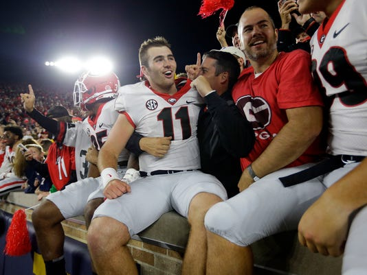 Georgia quarterback Jake Fromm (11) celebrates in the stands following the team's 20-19 win over Notre Dame in an NCAA college football game in South Bend, Ind., Saturday, Sept. 9, 2017. (AP Photo/Michael Conroy)