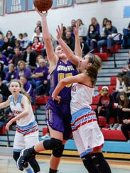 Oconomowoc sophomore Olivia Sobczak puts up a shot over Arrowhead's Lauren McDonald during the game at Arrowhead in December.