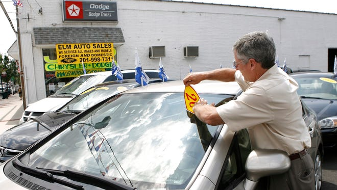Greg Signore, owner of Elm Auto Sales, is pictured at his used car business in Kearny, N.J., in this 2009 file photo.