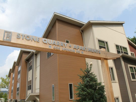 The front gate of Stone Quarry Apartments, with the