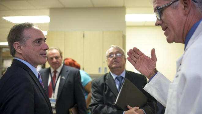 Dr. David Shulkin (left, VA's new undersecretary for health) talks with Dr. Christopher Burke (right) during a July 17 tour of the Phoenix VA Medical Center.