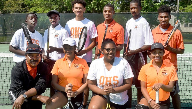 Members of the Opelousas High tennis team who participated in the annual OHS Tennis Tournament on Friday and Saturday at South City Park include Hillary Fisher, Shanequa Roberson and Jasmine Savant. Back row: Noah Smith, Trayveon Fontenot, Jason Hammock, Aaron Jackson, Tyrek Simmons and Keevon Clark. Pictured with the team is tennis coach Rubin Simmons.