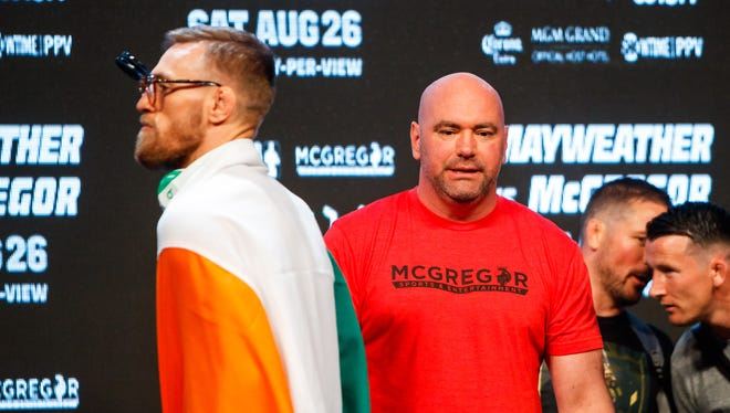Conor McGregor (left) and UFC president Dana White during weigh ins for McGregor's boxing match with Floyd Mayweather in 2017.