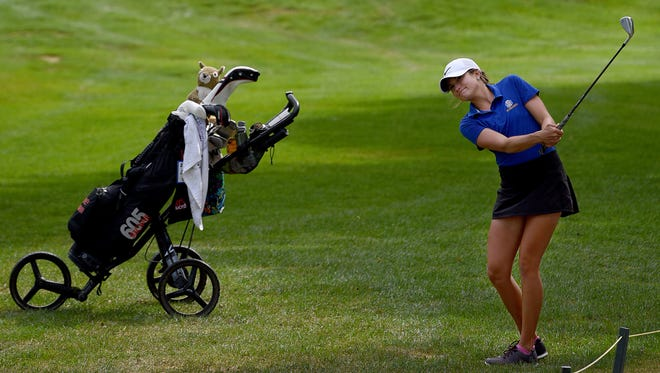 Sydney Bormann moves the ball to hole 14 at Willow Run golf course on Friday.