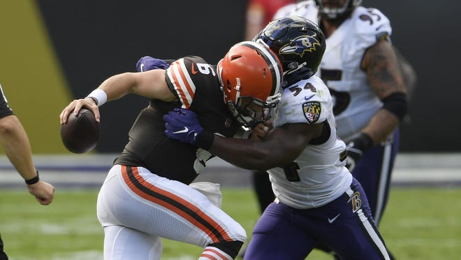 Baltimore Ravens linebacker Tyus Bowser, right, sacks Browns quarterback Baker Mayfield during the second half Sunday in Baltimore.