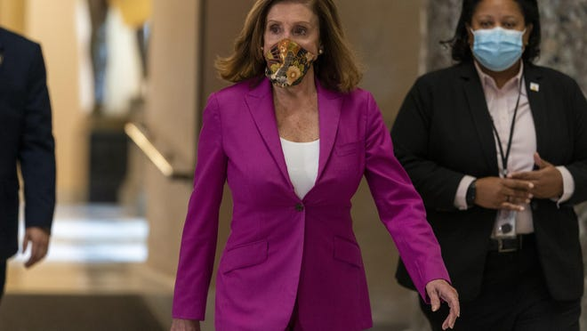 House Speaker Nancy Pelosi walks to her office Monday on Capitol Hill in Washington.