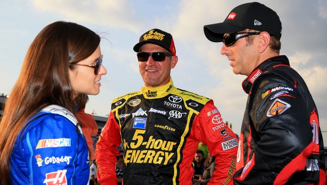 Clint Bowyer, center, and Greg Biffle, right, won the two segments of the Sprint Showdown to transfer into the Sprint All-Star Race. Danica Patrick, left, won the fan vote and will race as well.