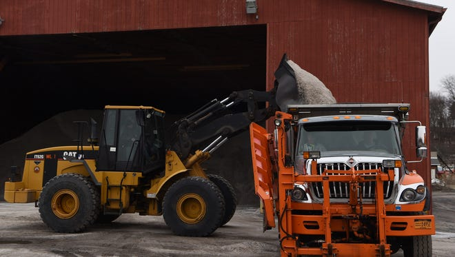 A salt truck is loaded up in preparation for the incoming snow at the Dutchess County Department of Public Works in the Town of Poughkeepsie.