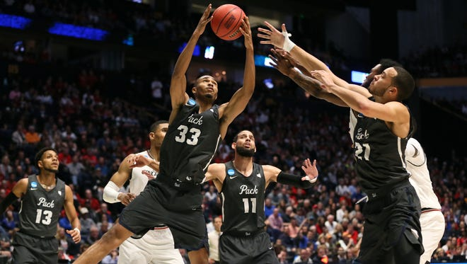 in the first half of the second-round South Region NCAA Tournament game between the Nevada Wolf Pack and the Cincinnati Bearcats, Sunday, March 18, 2018, at Bridgestone Arena in Nashville. At halftime, Cincinnati leads 44-32.
