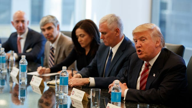 Then-President-elect Donald Trump speaks during a meeting with technology industry leaders at Trump Tower in New York in December 2016. From left are Amazon founder Jeff Bezos, Alphabet CEO Larry Page, Facebook COO Sheryl Sandberg, Vice President-elect Mike Pence, and Trump.