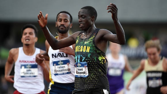 Jun 8, 2016; Eugene, OR, USA; Edward Cheserek of Oregon celebrates after winning the 10,000m in 29:09.57 during the 2016 NCAA Track and Field championships at Hayward Field. Mandatory Credit: Kirby Lee-USA TODAY Sports