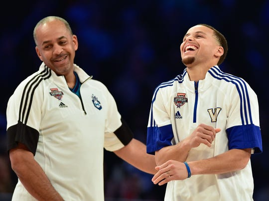Dell Curry, left, and son  Stephen celebrate during