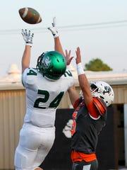 Iowa Park's Kason Dickerson hauls in a touchdown catch