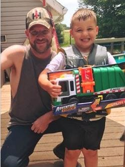 Rumpke driver Joe King recently brought Keegan Taylor, 4, of Ashland, a toy garbage truck. The boy waits for King each week at the window of his house on Township Road 1045 in Ashland County and King waves and blows his horn.