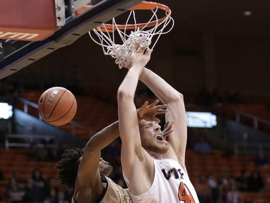 UTEP's Matt Willms is fouled from behind by FIU's Hassan