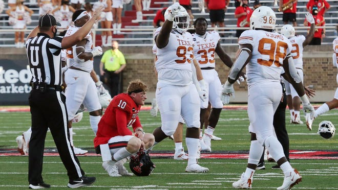 Texas Tech quarterback Alan Bowman (10) slumps amid celebrating Texas players after the Red Raiders' 63-56 overtime loss Sept. 26 at Jones AT&T Stadium. It was the first of two games the Red Raiders have lost this season after leading in the fourth quarter.