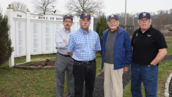 Members of Ardsley American Legion Post 458 at Pascone Park in Ardsley: Frank Pagani, Commander Efrain Hernandez, Bill Rudy and Stephen Wittenberg.
