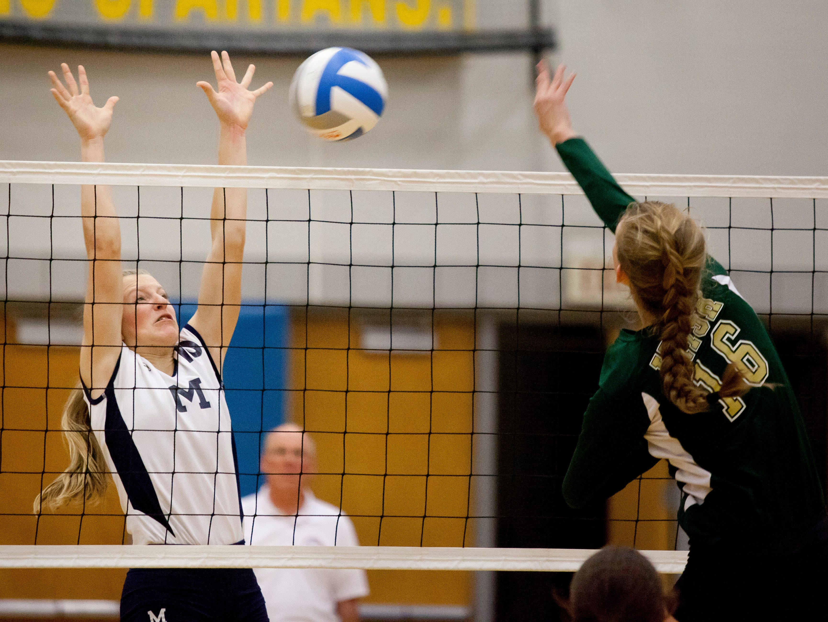 Marysville sophomore Hannah Delor blocks a spike during a regional semifinal volleyball game Tuesday, November 10, 2015 at Imlay City High School.