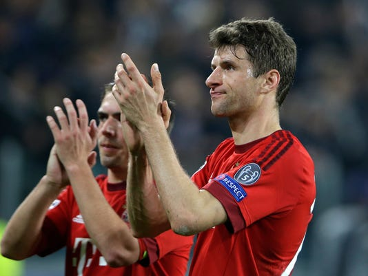 Bayern's Philipp Lahm, left, and Thomas Mueller acknowledge the fans after playing 2-2 during the Champions League, round of 16, first-leg soccer match between Juventus and Bayern Munich at the Juventus stadium in Turin, Italy, Tuesday, Feb. 23, 2016. (AP Photo/Luca Bruno)