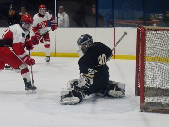 North Rockland forward Luke MacMillan is stopped by Clarkstown goalie Tim Cavanagh in the first period of a recent game at Sport-O-Rama.