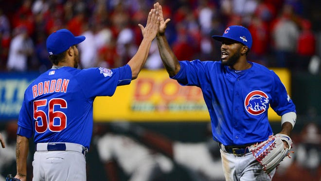 Cubs closer Hector Rondon and outfielder Dexter Fowler celebrate a Game 2 conquest of the Cardinals.