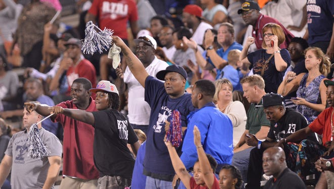 Park Crossing fans celebrate during their game with Carver at Cramton Bowl on Thursday, Oct. 9, 2014.